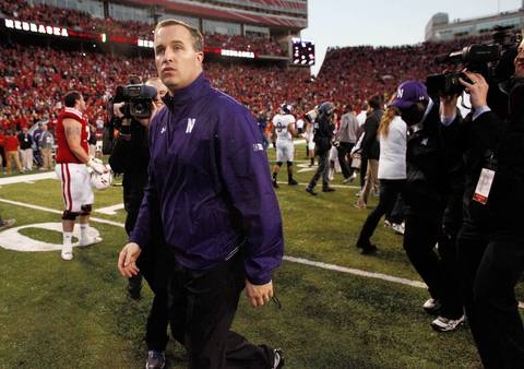Northwestern head coach Pat Fitzgerald leaves the field after losing on the last play of the game to Nebraska.