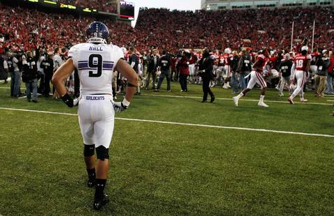 Northwestern safety Jimmy Hall watches Nebraska players celebrate after winning the game on the last play of the game.