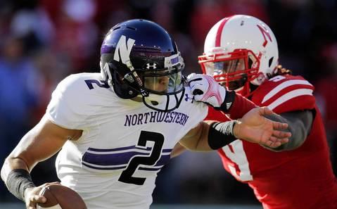 Nebraska's Jason Ankrah sacks Northwestern quarterback Kain Colter in the second quarter.