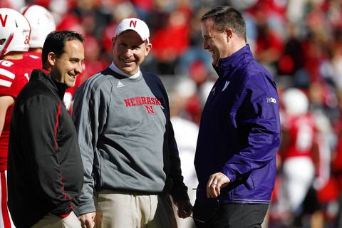 Nebraska defensive coach John Papuchis, coach Bo Pelini and Northwestern coach Pat Fitzgerald laugh before the game at Memorial Stadium.