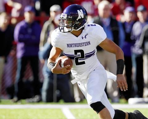 Northwestern quarterback Kain Colter runs against Nebraska.