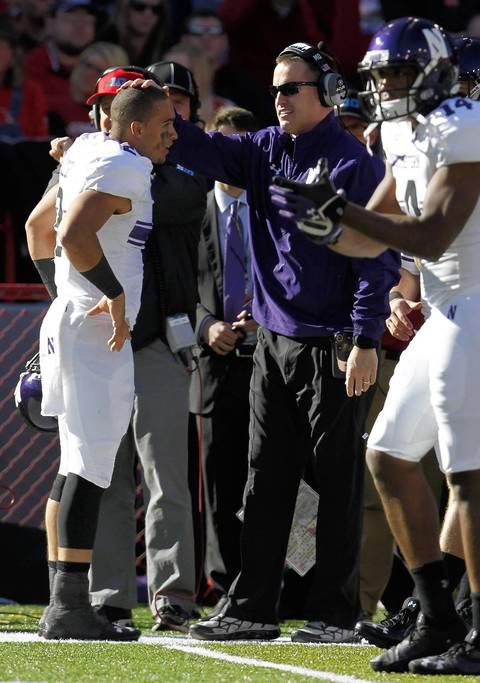 Northwestern coach Pat Fitzgerald congratulates quarterback Kain Colter after a touchdown.