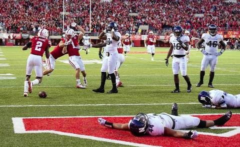 Northwestern reacts as Nebraska celebrates a win as the final seconds ran out.