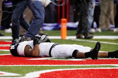 Northwestern linebacker Chi Chi Ariguzo lies in the end zone after Nebraska scored the game-winning touchdown on the last play of the game.