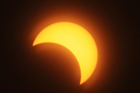 A partial solar eclipse is seen over the Sudanese capital Khartoum, on November 3, 2013. The rare solar eclipse will sweep across parts of Africa, Europe and the United States as the moon blocks the sun either fully or partially, depending on the location.