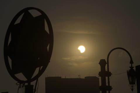 A partial solar eclipse is seen over the Egyptian capital Cairo, on November 3, 2013. The rare solar eclipse will sweep across parts of Africa, Europe and the United States as the moon blocks the sun either fully or partially, depending on the location.