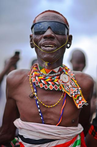 "A man from the Rendile tribe watches a total hybrid eclipse in Sibiloi national Park in Turkana on November 3, 2013. Astronomy enthusiasts in Kenya caught a partial glimpse of a rare ""Hybrid Total Eclipse"" which hasn't been witnessed in Africa for over 40 years, though weather hampered a view of the complete eclipse."