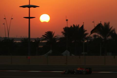 Sebastian Vettel of Germany and Infiniti Red Bull Racing drives as a rare hybrid solar eclipse takes place during the Abu Dhabi Formula One Grand Prix at the Yas Marina Circuit on November 3, 2013 in Abu Dhabi, United Arab Emirates.