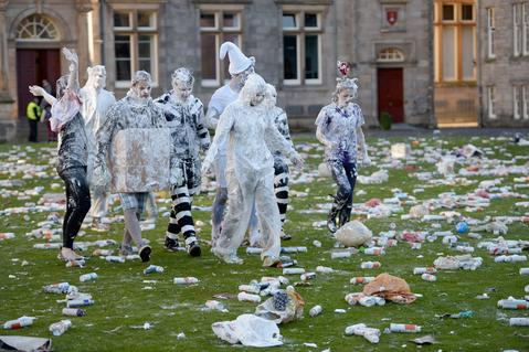Students from St Andrew's University indulge in a tradition of covering themselves with foam to honour the 'academic family' on November 4, 2013, in St Andrews, Scotland. Every November the 'raisin weekend' which is held in the university's St Salvator's Quadrangle, is celebrated and a gift of raisins (now foam) is traditionally given by first year students to their elders as a thank you for their guidance and in exchange they receive a receipt in Latin.