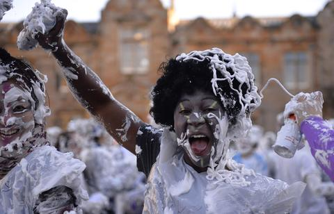 Students from St Andrews University are covered in foam as they take part in the traditional 'Raisin Weekend' in the historic St Salvator's Quad, in St Andrews, Scotland November 4, 2013. The weekend, which begins on Sunday, involves rituals for new students, culminating in a foam fight on Monday morning.