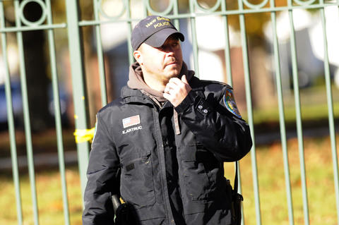 A New Britain Police Offier mans the barricade on campus Monday.