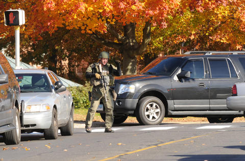 A heavily armed man about to head to the dormatory where a man with a gun was reported Monday,