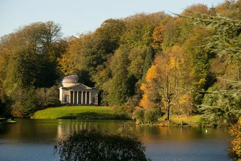 The sun shines on trees that are displaying their autumn colours surrounding the lakeside Pantheon at the National Trust's Stourhead on November 4, 2013 in Wiltshire, England. After the recent stormy weather, in many parts of the UK the autumn colours of trees are beginning to reach their peak as the season moves towards winter.