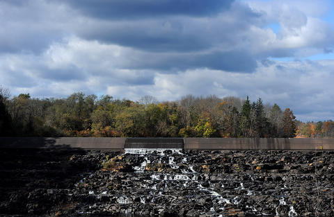 Fall colors highlight the top of the Lake Nockamixon spillway Friday afternoon.