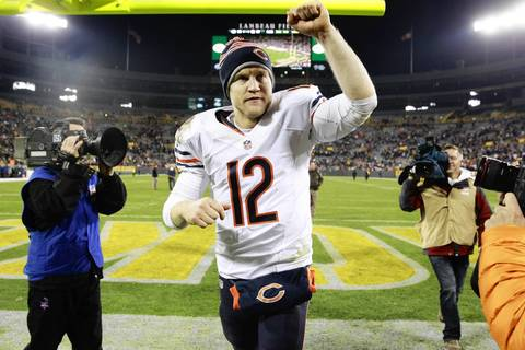Bears quarterback Josh McCown celebrates his team's win over the Packers.