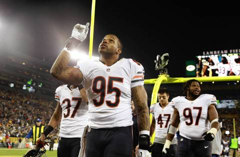 Bears linebacker Larry Grant points at the end of his team's win over the Packers.