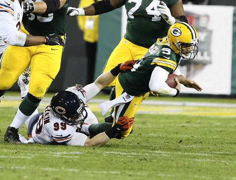 Defensive end Shea McClellin sacks Packers quarterback Seneca Wallace on the last play of the game.