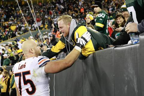 Kyle Long with a Packers fan at the end of his team's win.