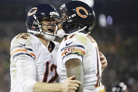 Alshon Jeffery celebrates with Josh McCown after catching a touchdown pass during the third quarter.