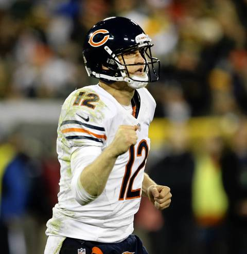 Bears quarterback Josh McCown pumps his fist after the touchdown by wide receiver Alshon Jeffery.