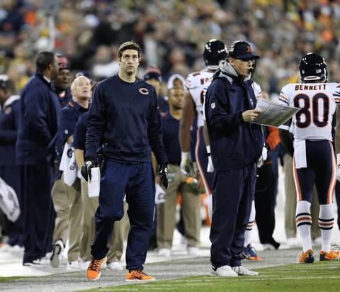 Bears quarterback Jay Cutler looks up at the scoreboard as head coach Marc Trestman calls plays in the first half.