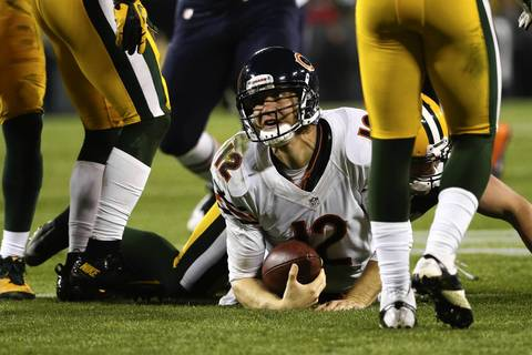 Josh McCown looks up after being tackled during the second quarter.