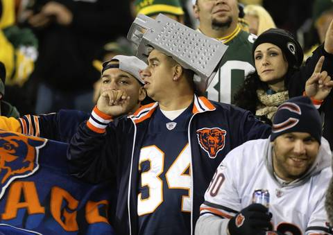 A Bears fan wears a cheese grater hat.