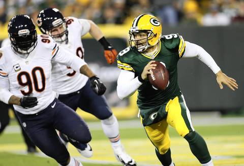 Packers quarterback Seneca Wallace scrambles from the Bears defense in the first half.