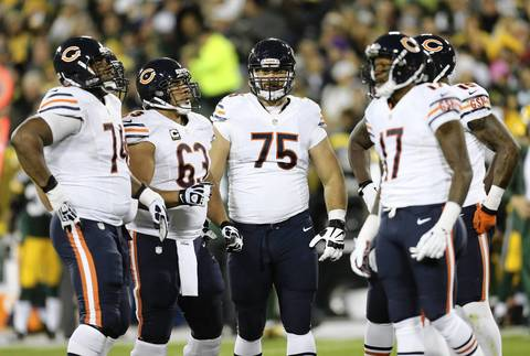 Kyle Long licks his chops before a play in the first half.