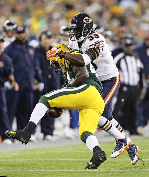 Charles Tillman breaks up a pass attempt to the Packers' James Starks.