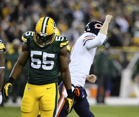 Packers linebacker Andy Mulumba walks away while Josh McCown celebrates a touchdown by Brandon Marshall.