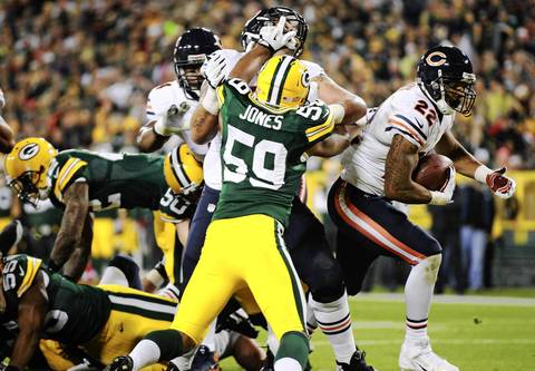 Matt Forte runs for a touchdown in the first half.