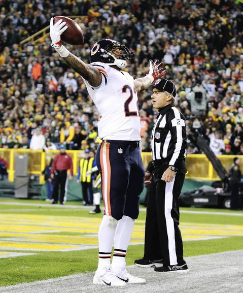 Matt Forte celebrates his touchdown run in the first half.