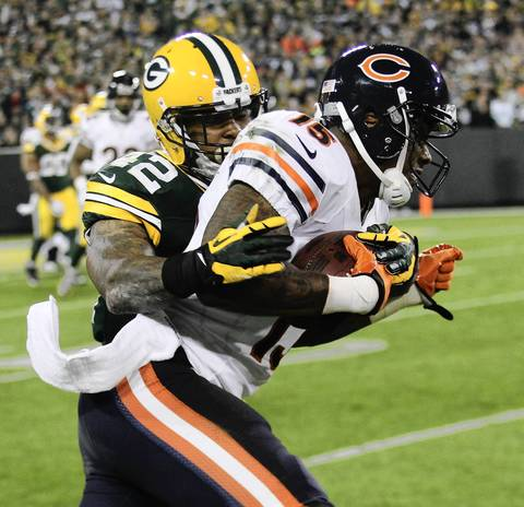 Brandon Marshall is tackled by the Packers' Morgan Burnett during the second quarter.