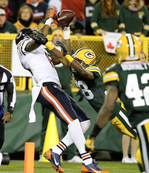 Chicago Bears wide receiver Brandon Marshall, left, catches a touchdown during the first quarter in Green Bay.