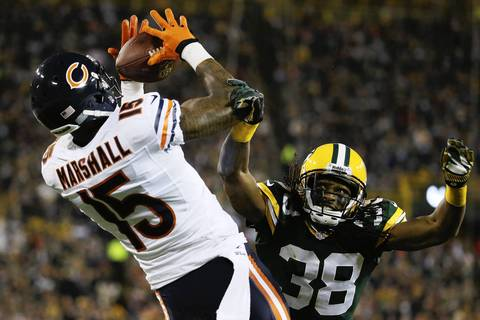 Chicago Bears wide receiver Brandon Marshall (15) catches a touchdown pass from quarterback Josh McCown during the first half at Lambeau Field.