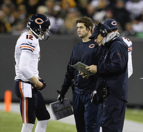 Josh McCown with coach Marc Trestman and Jay Cutler during the first quarter.