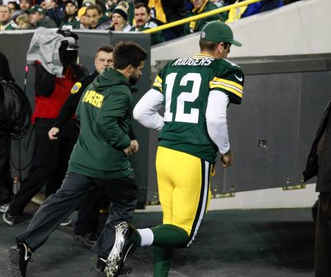 Packers quarterback Aaron Rodgers heads to the locker after getting injured on a play in the first quarter.