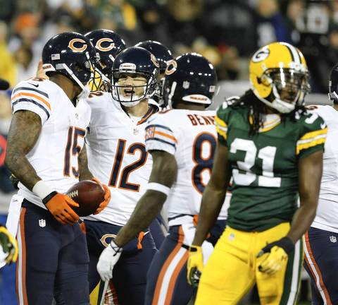 Chicago Bears wide receiver Brandon Marshall, left, celebrates his touchdown with quarterback Josh McCown (12), after scoring against the Green Bay Packers in the first quarter.