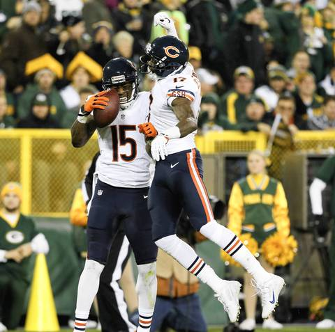 Chicago Bears wide receiver Brandon Marshall, left, celebrates his touchdown with wide receiver Alshon Jeffery, after scoring against the Green Bay Packers during the first quarter at Lambeau Field.