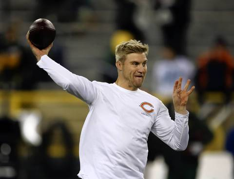 Chicago Bears quarterback Josh McCown (12) warms up before the Bears take on the Green Bay Packers.