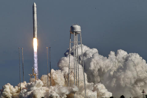 The Antares rocket launches into the air Sunday afternoon at NASA's Wallops Flight Facility.