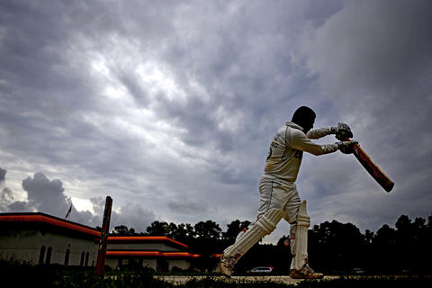 Devang Patel practices hitting the ball during warmups before the start of a cricket match at the Hindu Temple of Hampton Roads in Chesapeake.