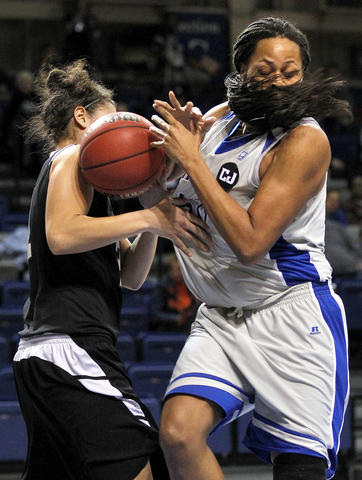 Christopher Newport University's Camry Green, right, fights for a rebound with Guilford College's Jaclyn Nucci, left, during Friday's first round Division III NCAA tournament game. CNU won 66-47.