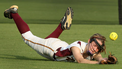 Emily May of Warwick just misses this catch in center field during the eighth inning of their semi-final game against Kecoughtan. No Mags, No Sales, No Internet, No TV