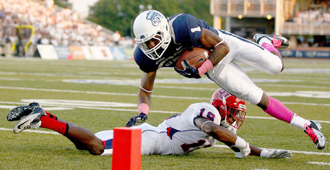 Jakwail Bailey of Old Dominion is stopped short of the endzone by Walt Aikens of Liberty during the first quarter Saturday in Norfolk. No Mags, No Sales, No Internet, No TV