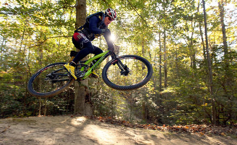 Adolfo Carrign catches some air during the mountain bike endurance race Saturday at the Tidewater Challenge. The event takes place over two days and features different styles of mountain bike racing. No Mags, No Sales, No Internet, No TV