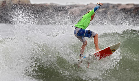 Ted Eberhardt catches a wave near Rudy Inlet duirng the boys division of he East Coast Surfing Championships Thursday in Virgina Beach. No Mags, No Sales, No Internet, No TV