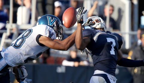 Eric Loper of Villanova gets his hand in the facemask of Nick Mayers of Old Dominion as he goes up for the pass during the third quarter Saturday. No Mags, No Sales, No Internet, No TV
