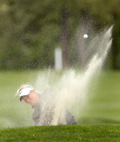 Suzann Petterson hits out of the bunker on the seventh fairway during the final round of the Kingsmill Championship Sunday in Williamsburg. No Mags, No Sales, No Internet, No TV